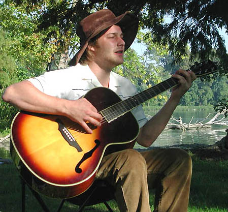 Brad Renfro playing guitar at Reelfoot Lake in West Tennessee